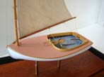 click to view detailed description of A 1:48 scale model of a circa 1921 Beetle Catboat made by Thomas Lauria