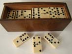 click to view detailed description of A fabulous set of large and thick all bone dominoes in a box dated 1919 with inscription