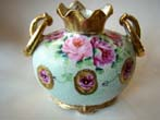click to view detailed description of A fabulous hand painted Nippon vase circa 1890