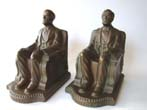 click to view detailed description of A lovely pair of bronze patinated antique bookends by Nuart circa 1924 depicting 'Lincoln in the chair.'
