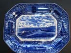 click to view detailed description of A fine and rare blue transfer printed Commemorative platter made in 1908 featuring Plymouth Plantation and the Pilgrims