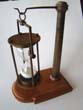 click to view detailed description of A 20th century hanging hour glass on stand