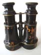 click to view detailed description of A 19th century pair of tortoiseshell mounted binoculars circa 1870