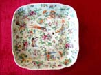 click to view detailed description of A Chinese Export porcelain and enameled square tray with exotic birds and butterflies circa 1830