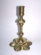 click to view detailed description of An English Georgian period Brass Petal Base Candlestick circa 1750