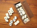 click to view detailed description of A Civil War period boxed set of 28 bone and ebony dominoes circa 1865