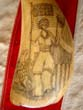 click to view detailed description of A beautiful late 19th or early 20th century patriotic themed scrimshawed whales tooth