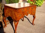 click to view detailed description of A beautiful English Queen Anne period walnut dressing table circa 1710-1730