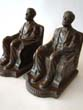 click to view detailed description of A pair of Lincoln in the chair bookends by NUART circa 1924