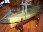click to view detailed description of A large19th century English Plank-on-frame Pond Boat set into a custom made mahogany cradle base