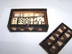 click to view detailed description of A set of 19th century Bone and Ebony Dominoes in a Porcupine Quill and Ebony Box circa 1875