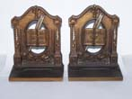 click to view detailed description of a pair of antique Bookends circa 1925 by Bradley & Hubbard depicting Literature and Knowledge