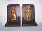 click to view detailed description of A pair of Antique Bookends circa 1900 by Bradley & Hubbard depicting John Alden (1599-1687)and his wife Priscilla who helped establish the Plymouth Colony in 1620.