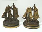 click to view detailed description of A Pair of Antique Bookends by Bradley & Hubbard depicting a two-masted schooner circa 1925