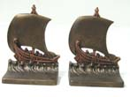 click to view detailed description of A Pair of Antique bookends by Bradley & Hubbard circa 1925 depicting a Phoenician or Roman trading ship