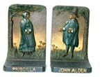 click to view detailed description of A pair of Antique Bookends by Bradley & Hubbard depicting John Alden & Priscilla circa 1910