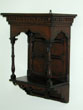 click to view detailed description of A Small 19th Century English Oak Canopy With Shelf Circa 1870.