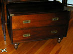 click to view detailed description of 20th Century Campaign Style low chest of drawers