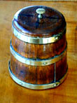 click to view detailed description of A Miniature Brass Bound Ships Harness Cask With Inlaid Lid Circa 1860