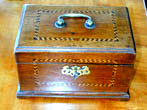 click to view detailed description of An English Red Walnut Tea Caddy Box Circa 1780.