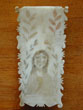 click to view detailed description of A Fine 19th Century Whale Ivory Scrimshawed Needle Holder