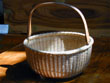 click to view detailed description of A Nantucket Basket Attributed to Ferdinan Sylvaro Circa 1910.