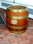 click to view detailed description of A 19th century Brass Bound Barrel With Later Applied Brass Coat-of-arms