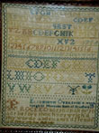 click to view detailed description of Needlework Sampler by Elizabeth Overend dated 1728