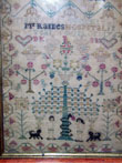 click to view detailed description of Adam and Eve Needlework Sampler by Mary Kelly 1762