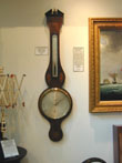 click to view detailed description of A Fine Inlaid Banjo Barometer Signed Torre of London circa 1810