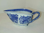 click to view detailed description of A Chinese Export Blue Fitzhugh Creamer with Strap Handle circa 1810.