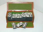 click to view detailed description of Beautiful 19th Century Cased Set of Mother-of-Pearl Mounted Dominoes