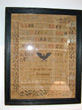 click to view detailed description of Rare American Needlework Sampler Signed