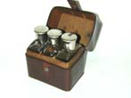 click to view detailed description of Antique Gentlemens Travelling Bottle/Flask Set in Leather Case circa 1900.
