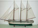 click to view detailed description of 19th Century Nantucket Sailor-Made Three-Masted Pond Boat