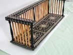 click to view detailed description of 19th century Ebony Bookstand With Porcupine Quill Spindles and Ivory Inlays