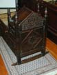 click to view detailed description of Antique English Oak Cradle Dated 1691