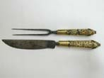 click to view detailed description of A 17th Century Ivory and Brass Handled Fork and Knife Set in Leather Sheath