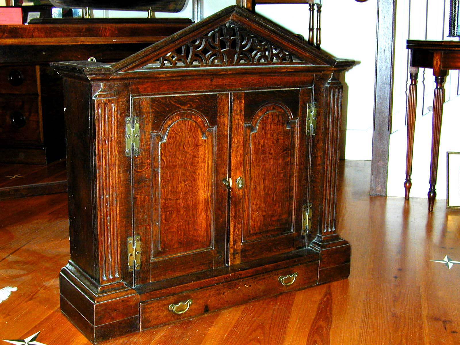 click to view detailed description of A beautiful George II period Oak Hanging Cupboard circa 1740