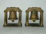 click to view detailed description of An Antique Pair of Liberty Bell Cast Iron Bookends circa 1910-1920