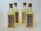 click to view detailed description of Four RARE Unopened Bottles of late 19th century Sperm Whale Oil.