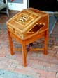 click to view detailed description of A 19th century Sea Captains Writing box with inlaid compass rose on the lid.