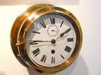 click to view detailed description of A late 19th century Ships Bulkhead Clock signed