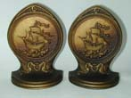 click to view detailed description of A Pair of BRADLEY & HUBBARD Bronze Bookends Depicting a 16th Century Galleon, circa 1920