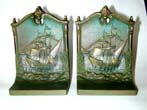 click to view detailed description of A Pair of BRADLEY & HUBBARD Antique Bookends Depicting The 'Mayflower' at Plymouth Harbor, circa 1910