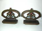 click to view detailed description of A Pair of BRADLEY & HUBBARD Painted Flower Basket Bookends Circa 1900