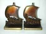 click to view detailed description of A Pair of early 20th century BRADLEY & HUBBARD Bookends Depicting a Roman Trading Ship