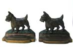 click to view detailed description of A Pair of BRADLEY & HUBBARD Antique Scottie Dog Bookends circa 1910.