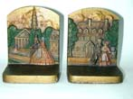 click to view detailed description of A Pair of BRADLEY & HUBBARD Colonial Town Antique Bookends circa 1920