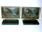 click to view detailed description of A Pair of Bradley & Hubbard Thatched Cottage Antique Bookends circa 1920